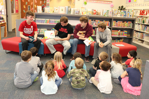 Boys Basketball Juniors/Seniors Read to MES Students